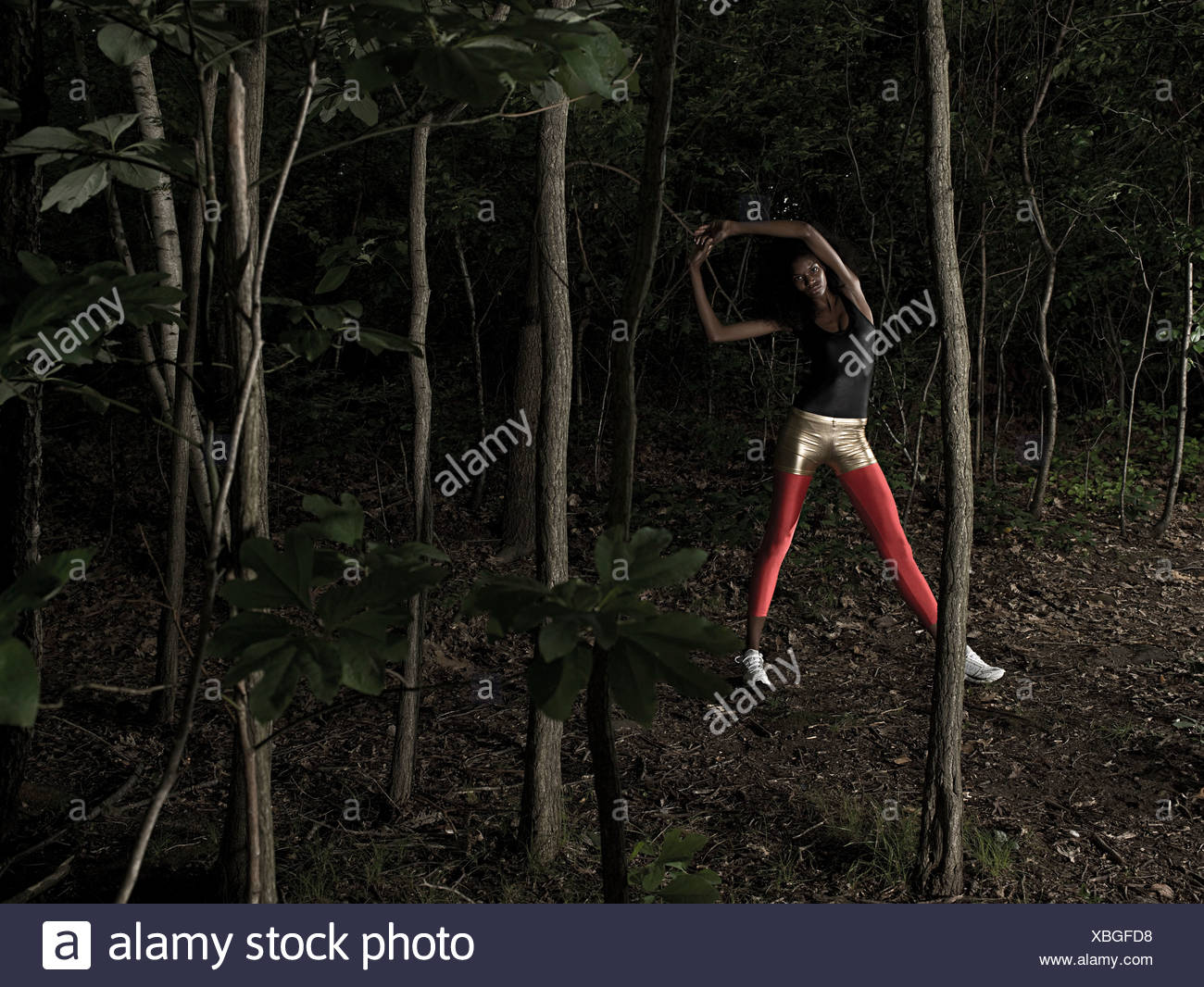 Female athlete in forest - Stock Image
