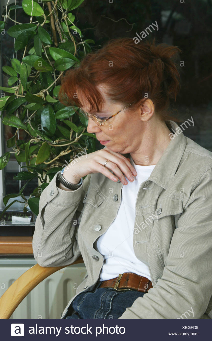 Sad middle aged woman - Stock Image