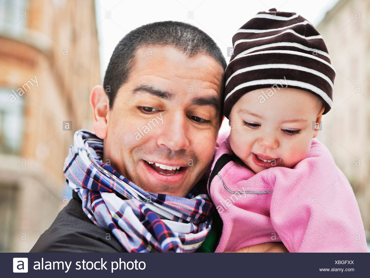 Close-up of father and baby (0-11 months) looking down - Stock Image