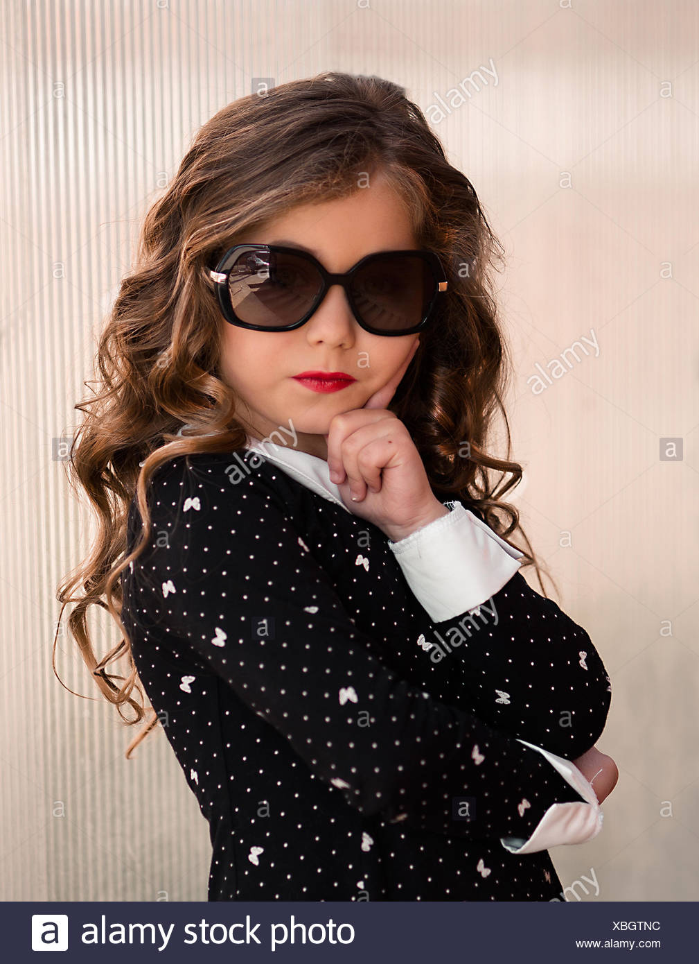 da9ecbf4f87 Fashion portrait of girl child. Sunglasses. Stylish and cute. Cheerful  serious little girl in sunglasses keeping arms crossed and looking up with  smile ...
