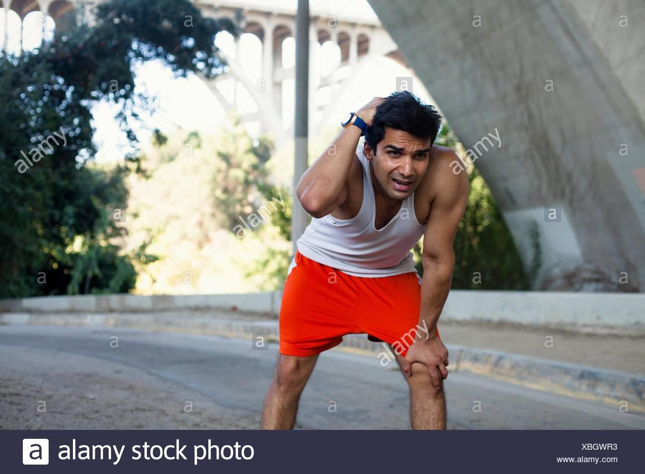 Jogger exhausted, taking break, Arroyo Seco Park, Pasadena, California, USA - Stock Image