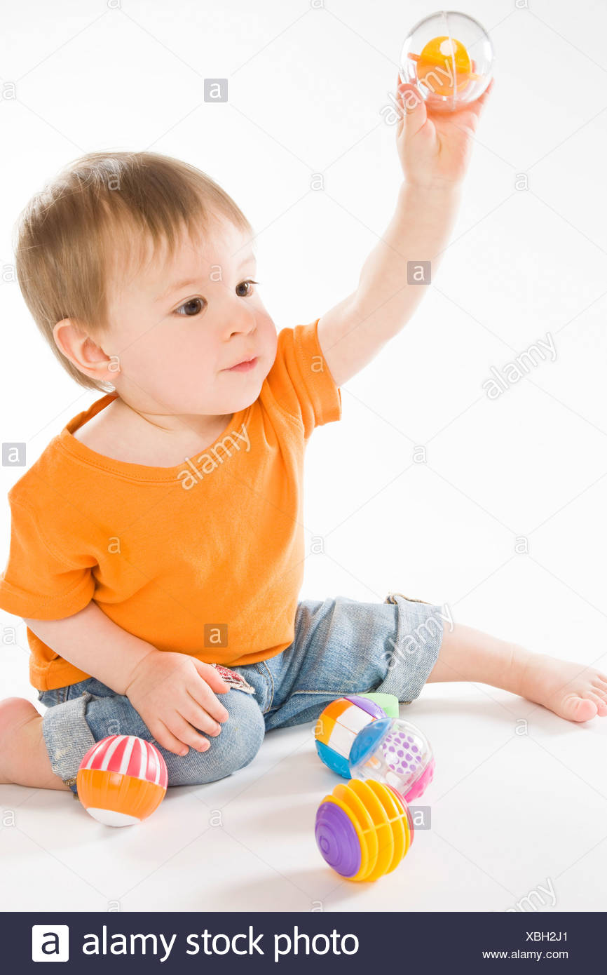 baby boy playing with balls Stock Photo