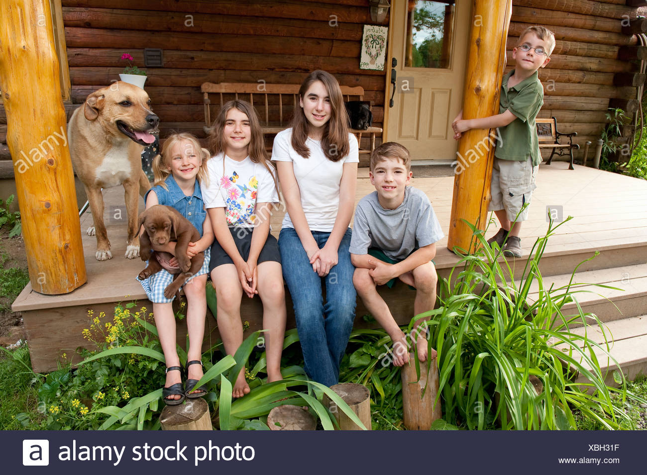 Family portrait in front of home - Stock Image