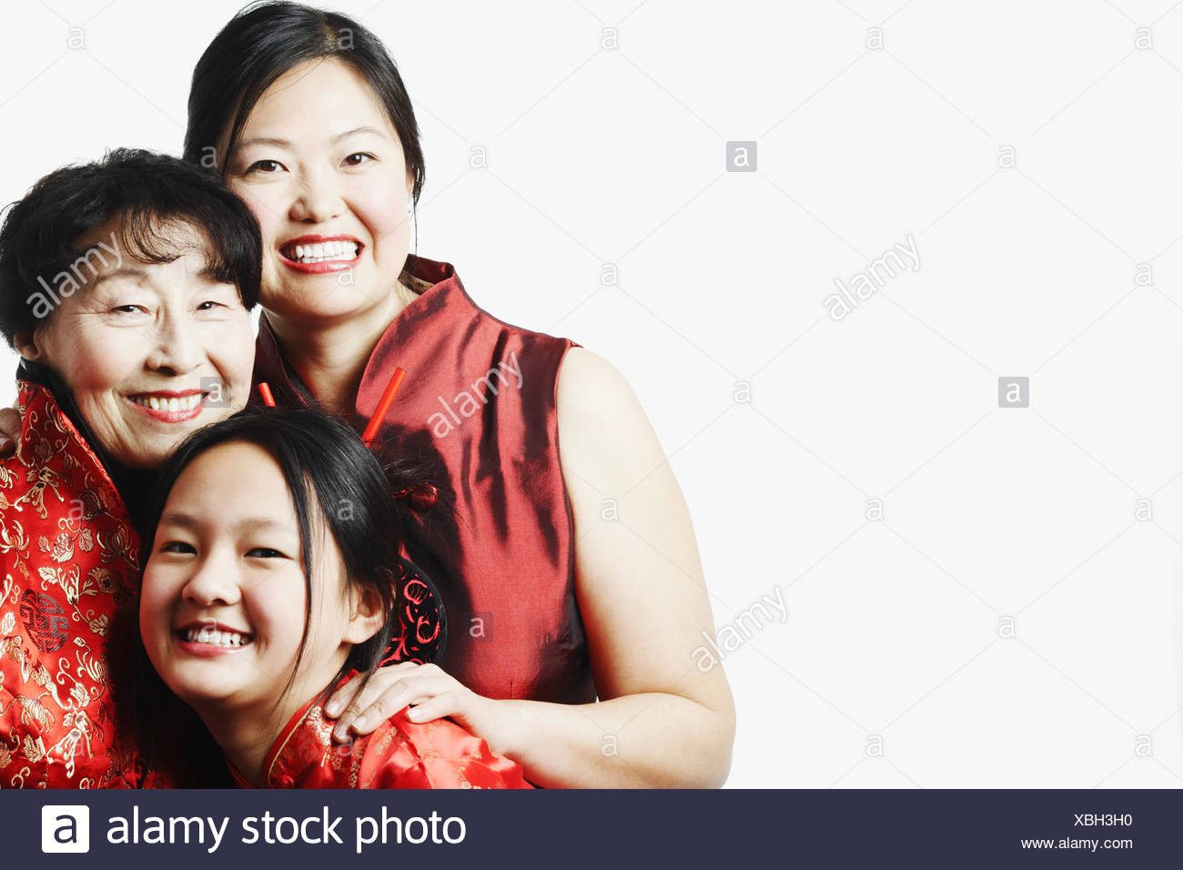 Portrait of a mother with her daughter and granddaughter smiling - Stock Image