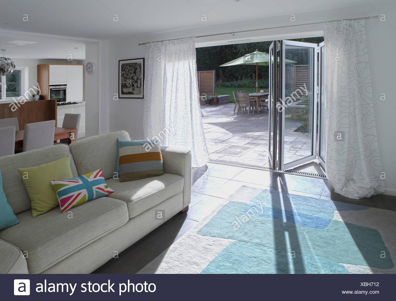 Open plan living area with open patio doors - Stock Image