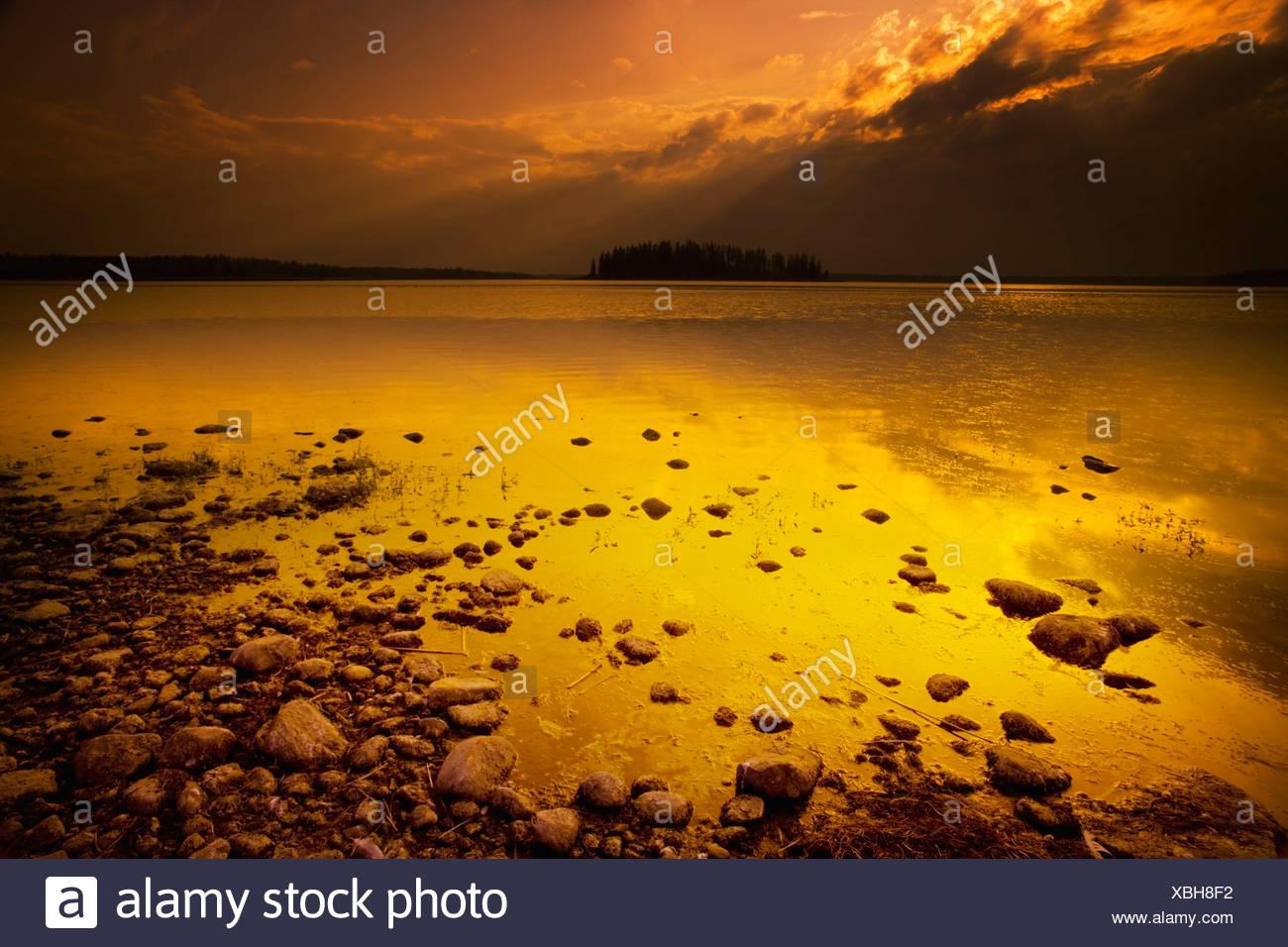 Alberta, Canada; A Lake At Dusk - Stock Image