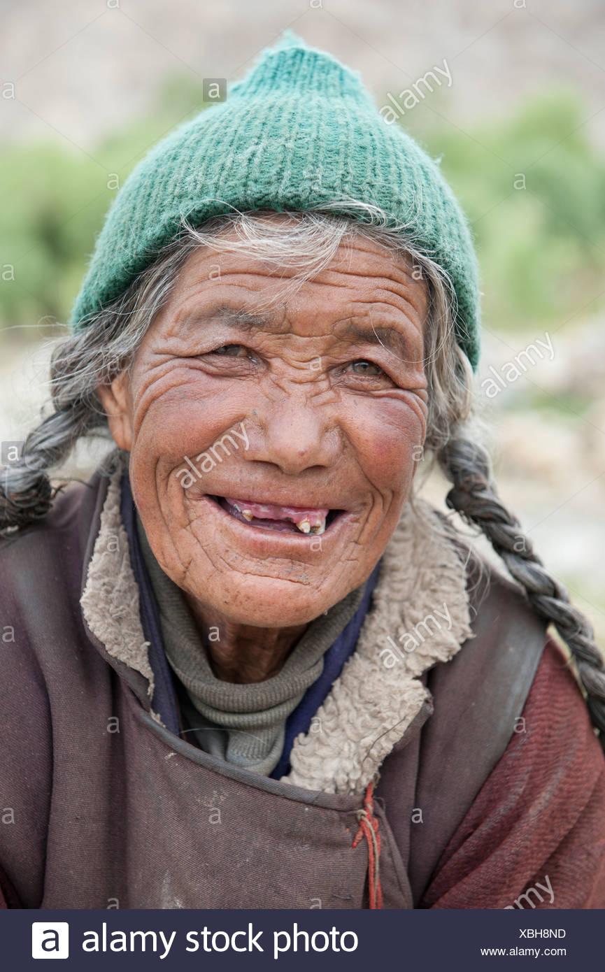 Portrait of an elderly woman, full of joy and missing teeth, Sakti near Leh, Ladakh district, Jammu and Kashmir, India - Stock Image