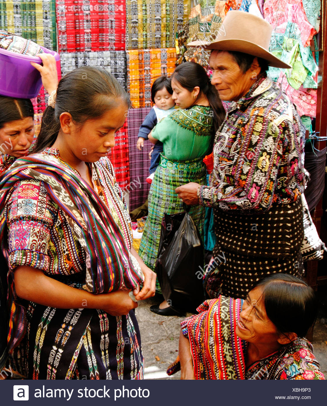 Natives from different regions trade at the Solola Sunday market, Solola Department, Guatemala, Central America - Stock Image