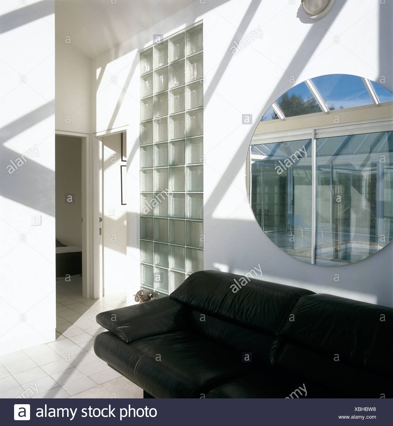 Amazing Circular Mirror Above Black Leather Sofa Next To Glass Block Pdpeps Interior Chair Design Pdpepsorg