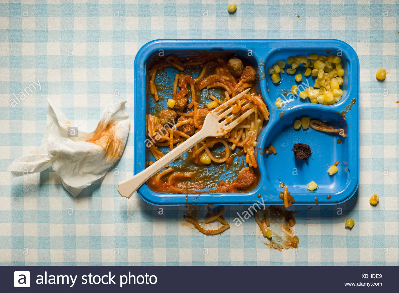 Eaten TV Dinner with plastic fork and used napkin - Stock Image