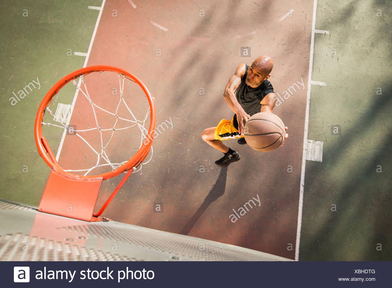 Basketball player shooting - Stock Image