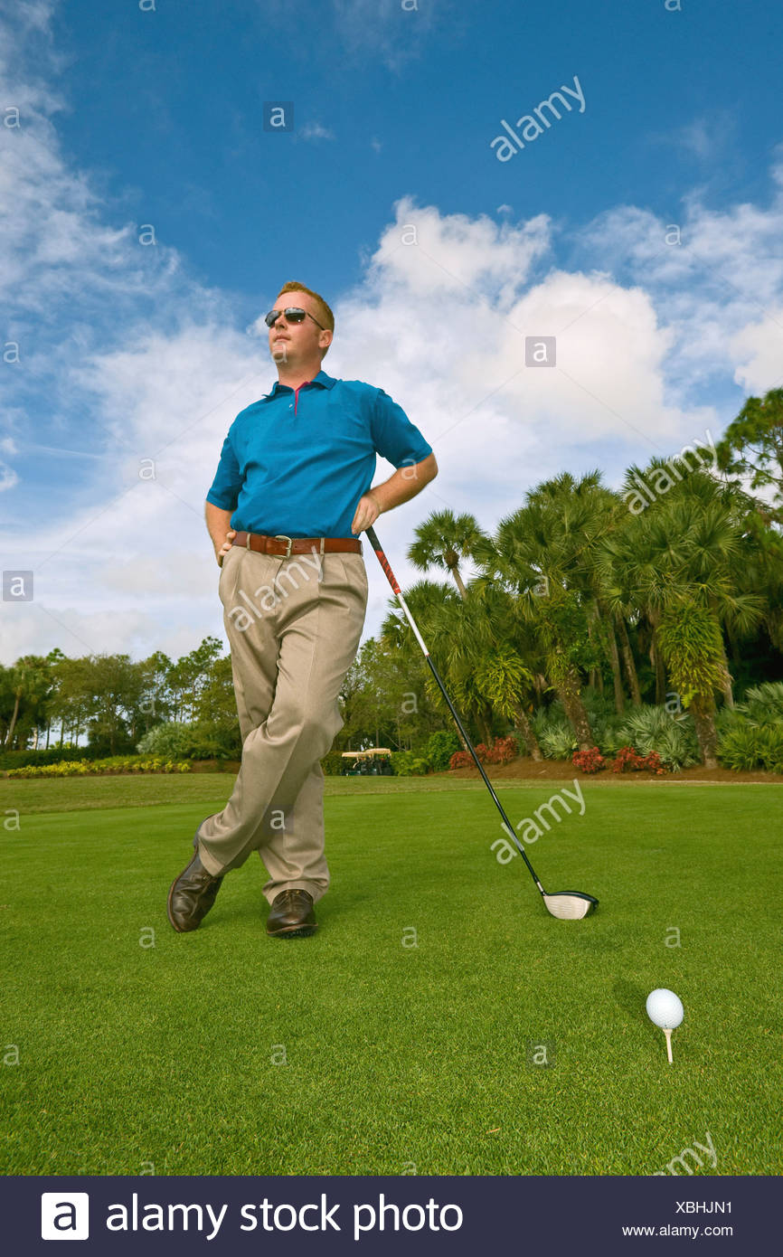 Golfer at tee, waiting to tee off - Stock Image