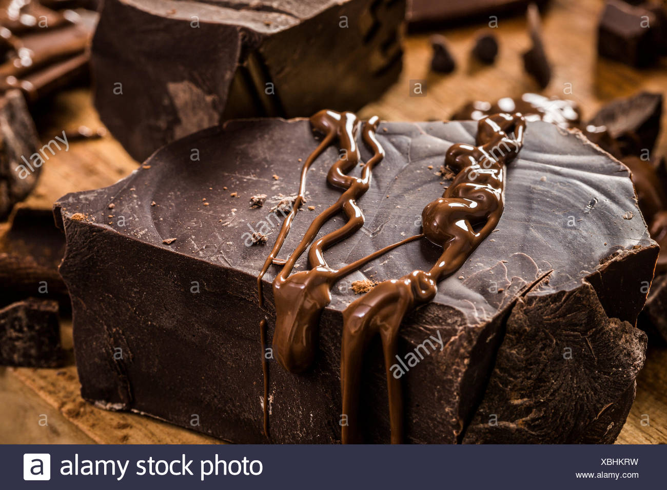 Melted chocolate on big dark chocolate chunk - Stock Image