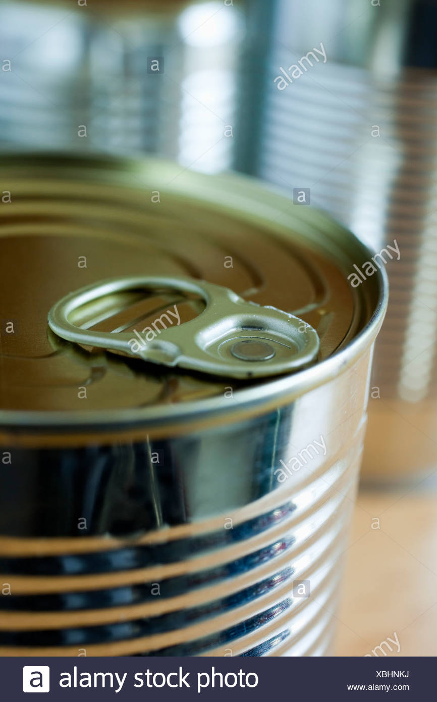 Cropped image of drinking can - Stock Image