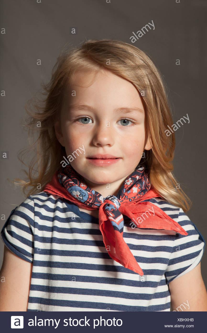Girl wearing silk scarf in studio - Stock Image