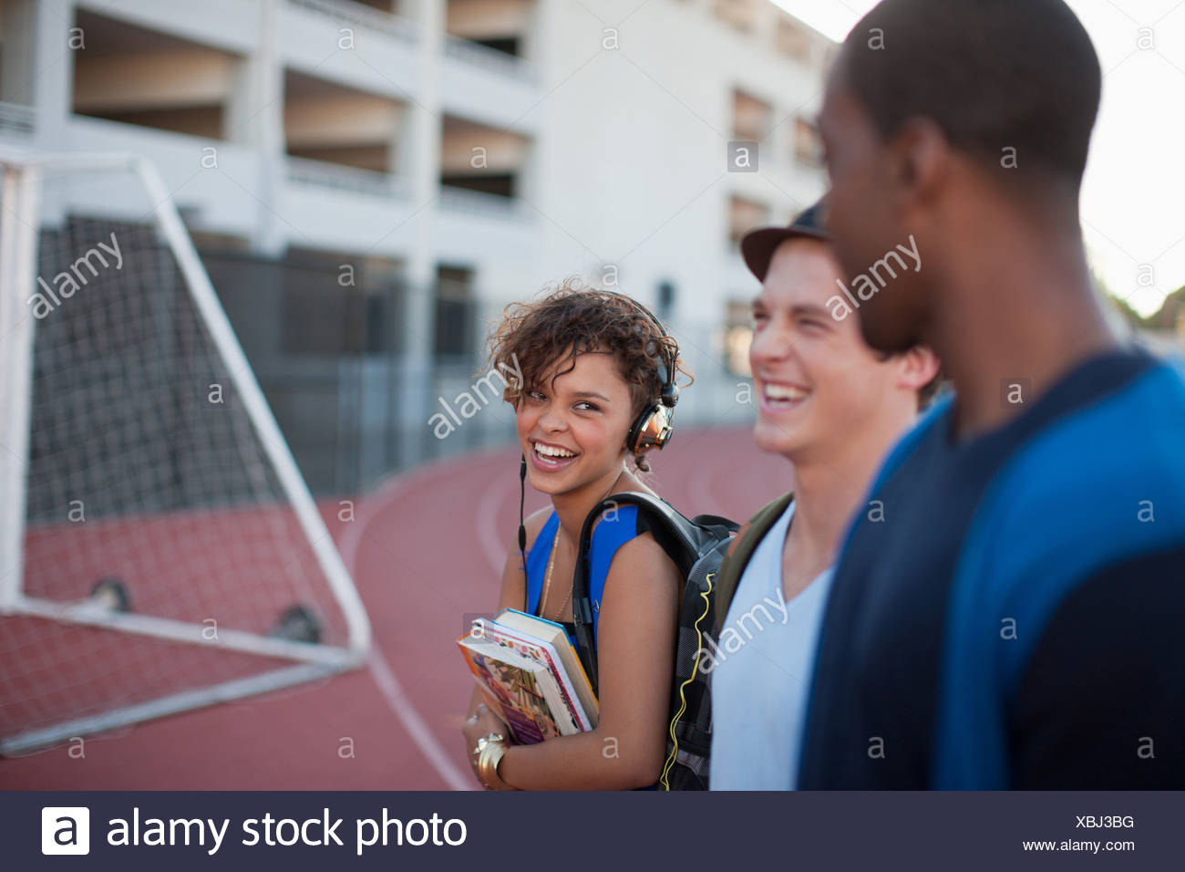 Three students laughing - Stock Image