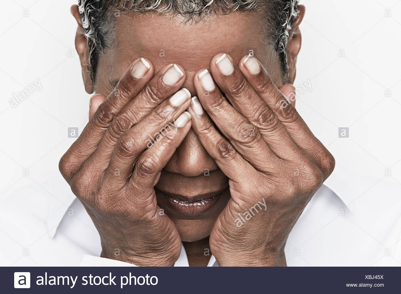 Senior woman covering her eyes - Stock Image