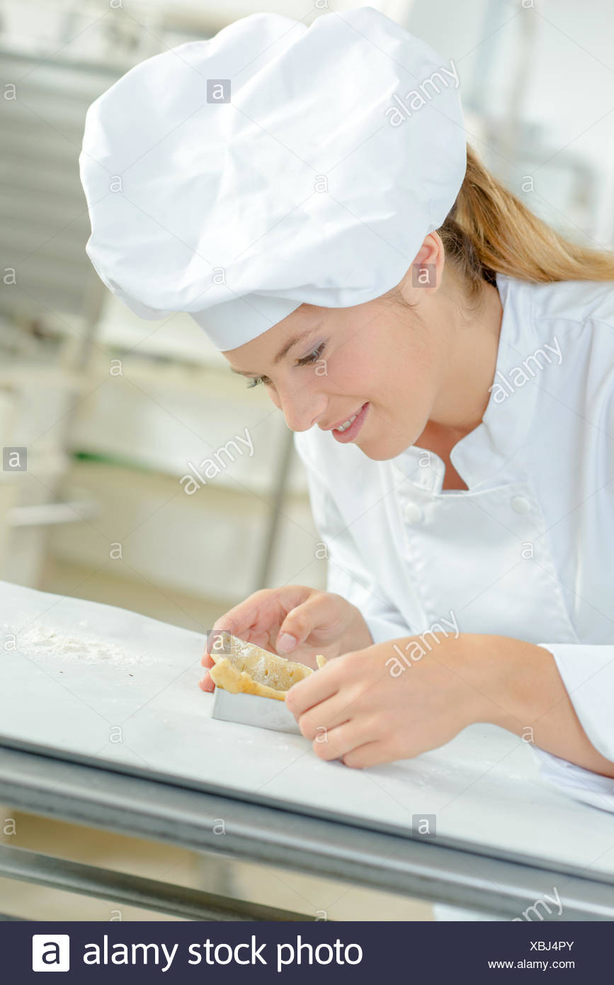 Woman making a fancy dessert - Stock Image