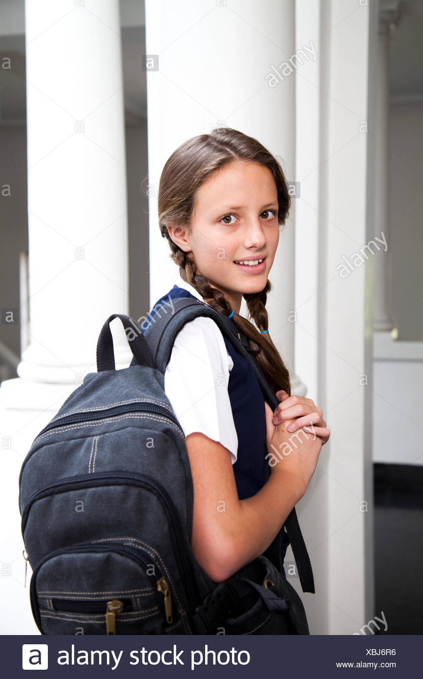 Portrait of a teenage student carrying a rucksack - Stock Image