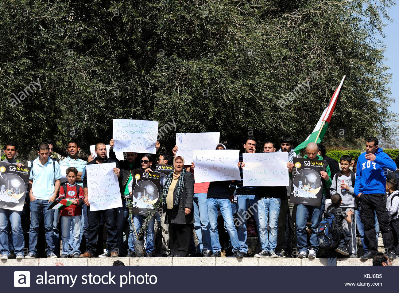 Palestinians demonstrating peacefully with placards and signboards on the steps outside the Damascus Gate against the settlement - Stock Image
