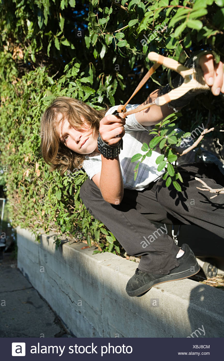 A boy aiming a catapult - Stock Image