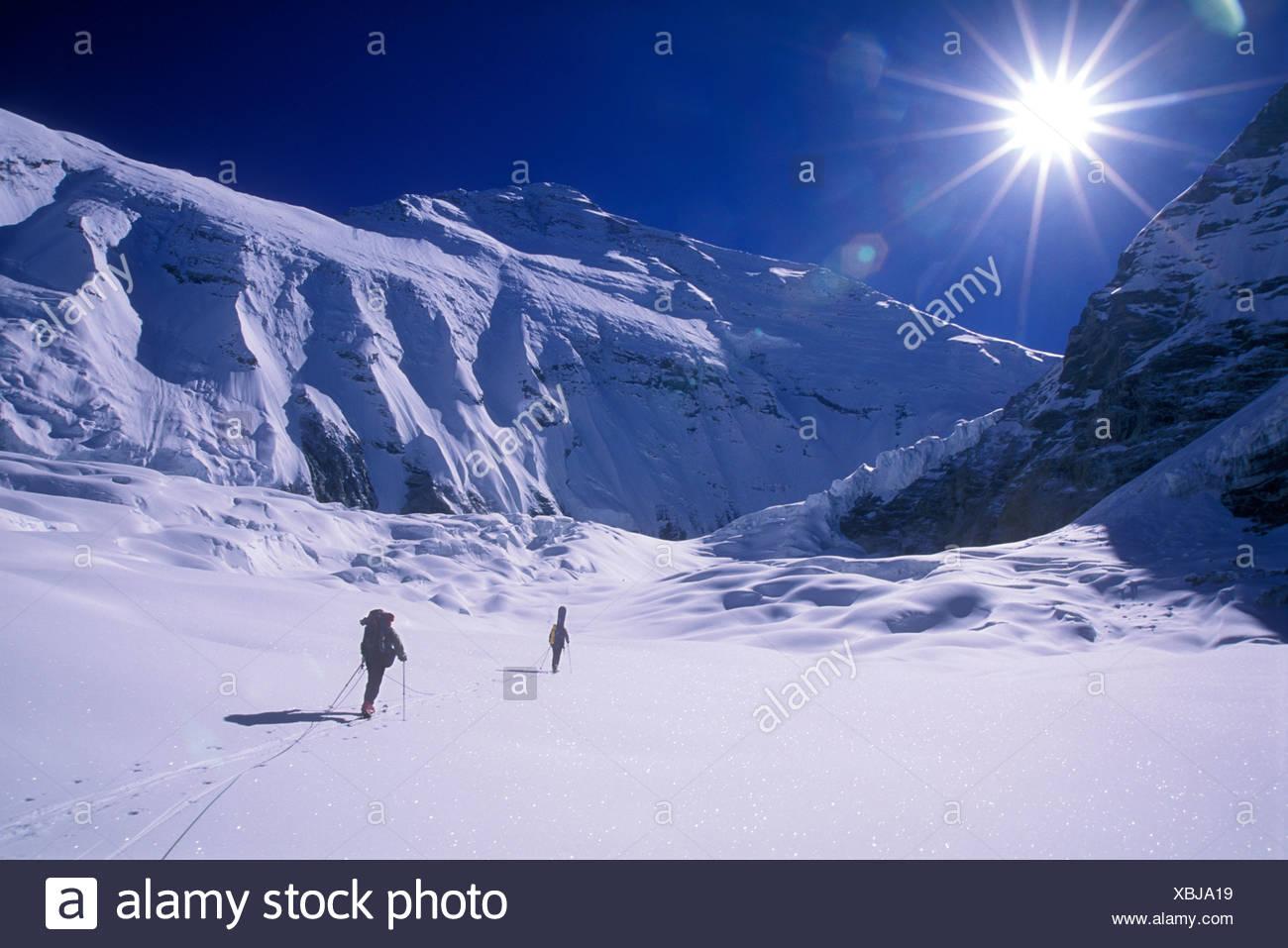 Two men ski touring up the Central Rongbuk Glacier towards Mount Everest - Stock Image