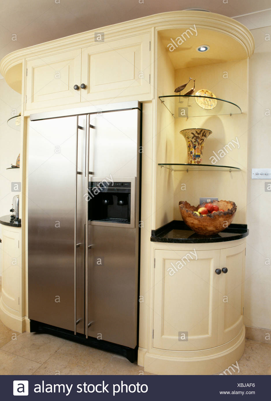 Cream kitchen unit with built-in stainless steel American ...