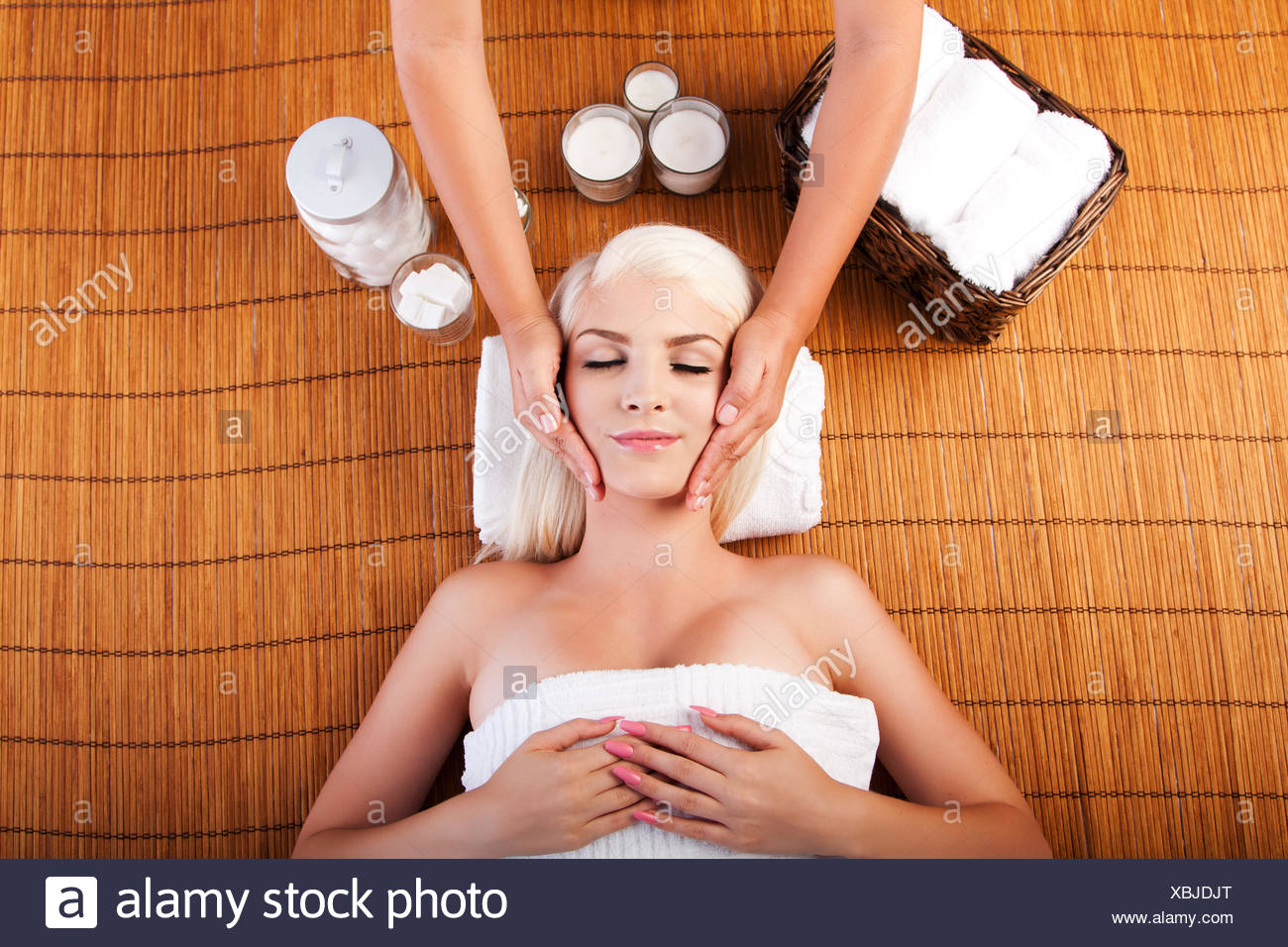 Relaxation pampering facial massage - Stock Image