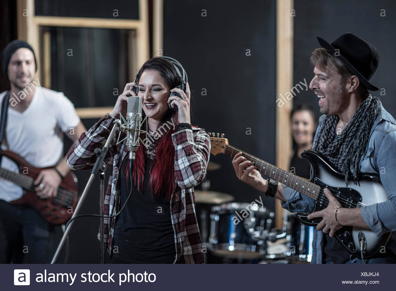 Rock band session in recording studio - Stock Image