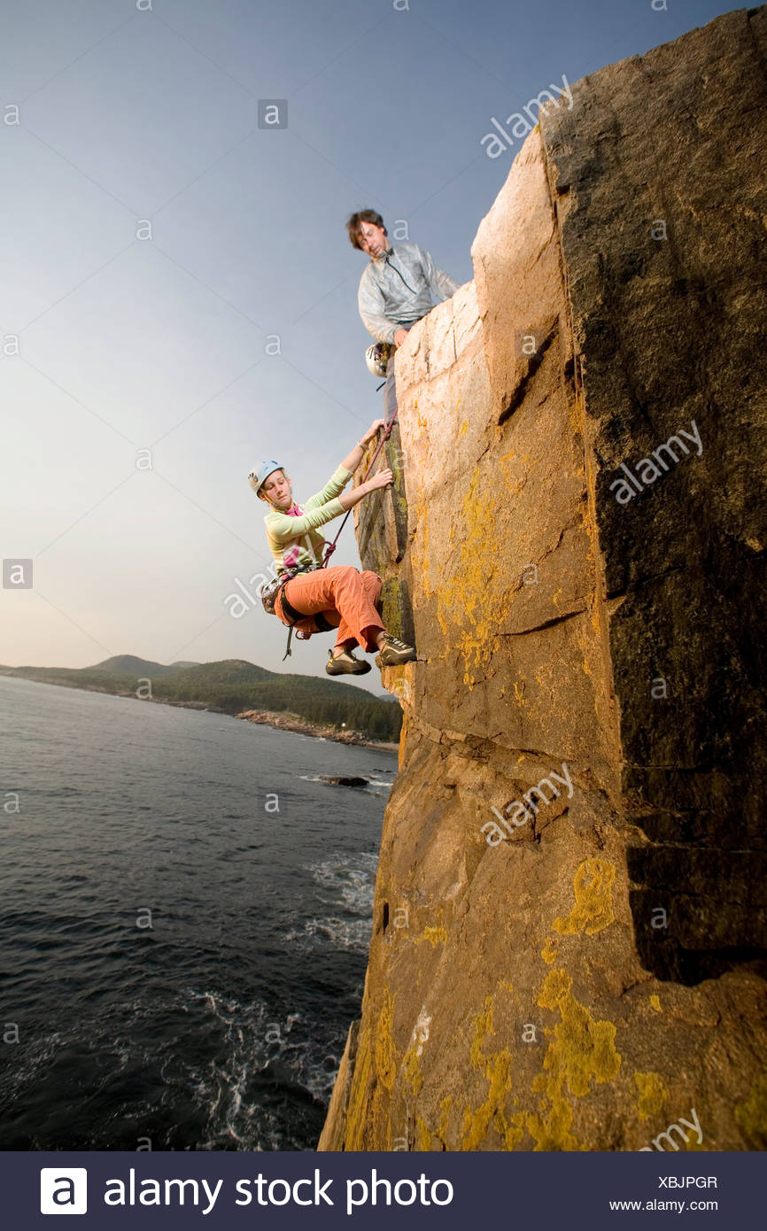 Rock Climbing on oceanside cliffs, Maine. - Stock Image
