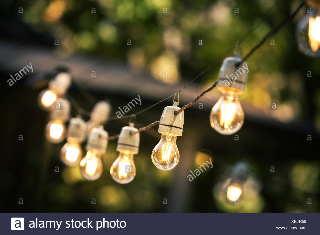 String of outdoor lights night lighting stock photos string of outdoor string lights hanging on a line in backyard stock image aloadofball Gallery