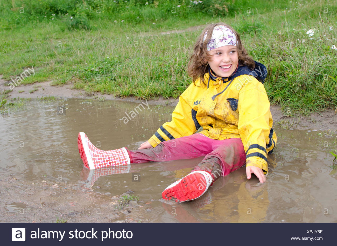 Girl in the puddle - Stock Image