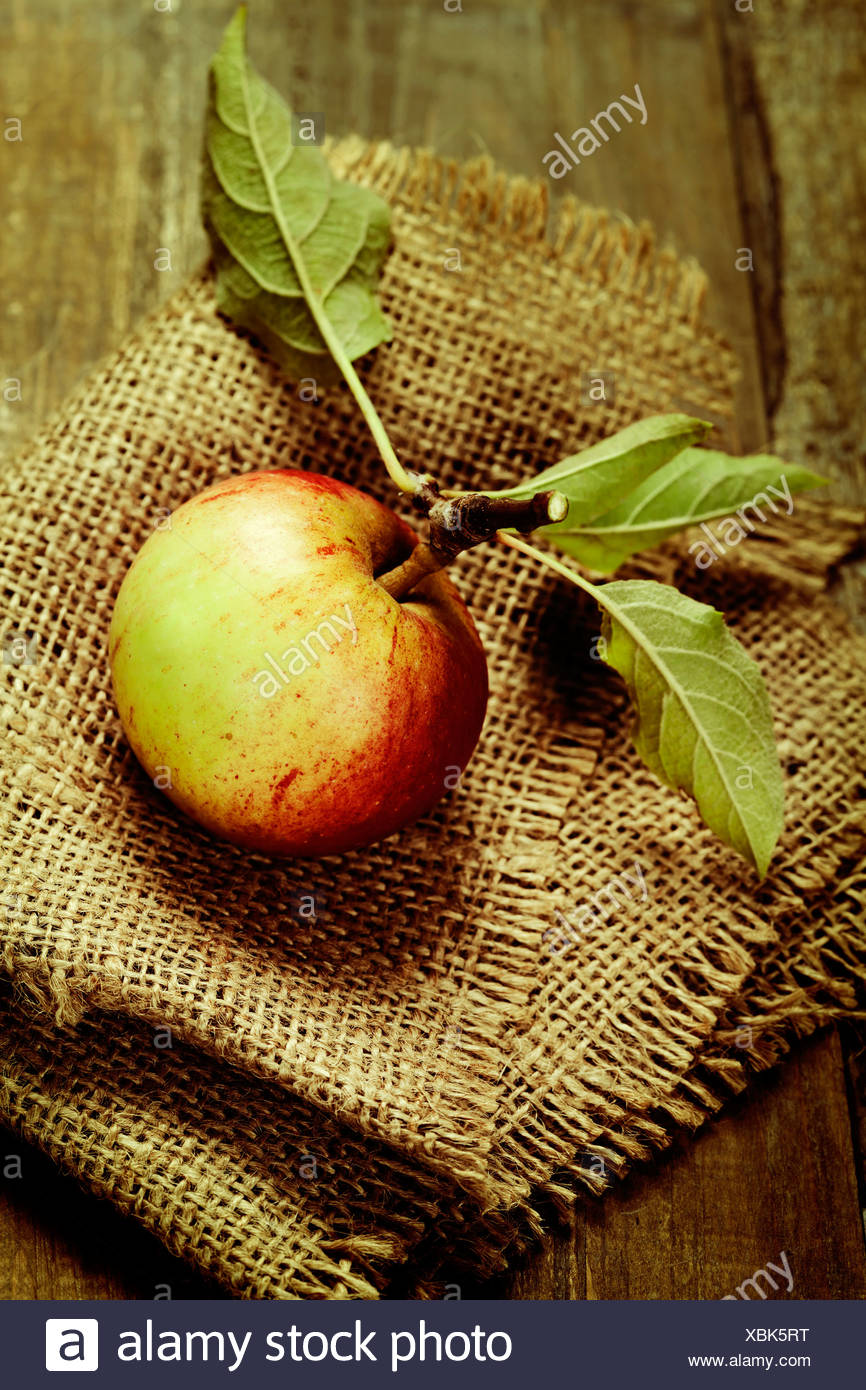 Healthy ripe apple on a wooden table - Stock Image