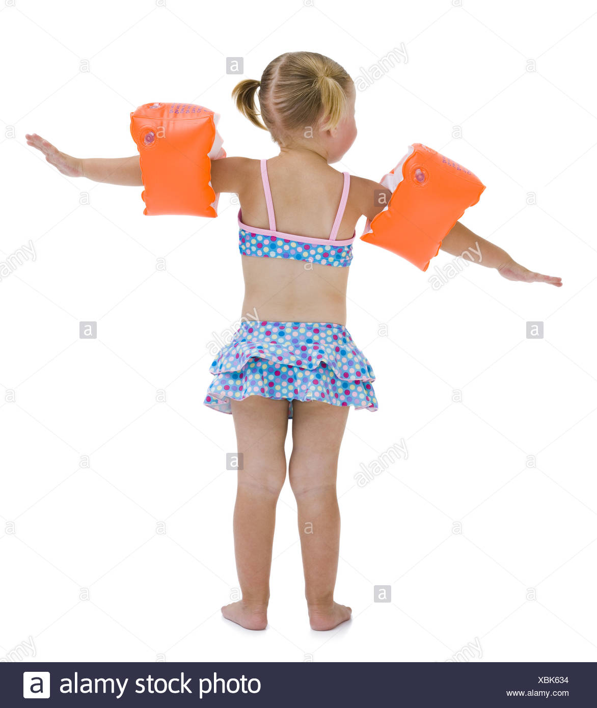Young girl with personal flotation devices around arms Stock Photo