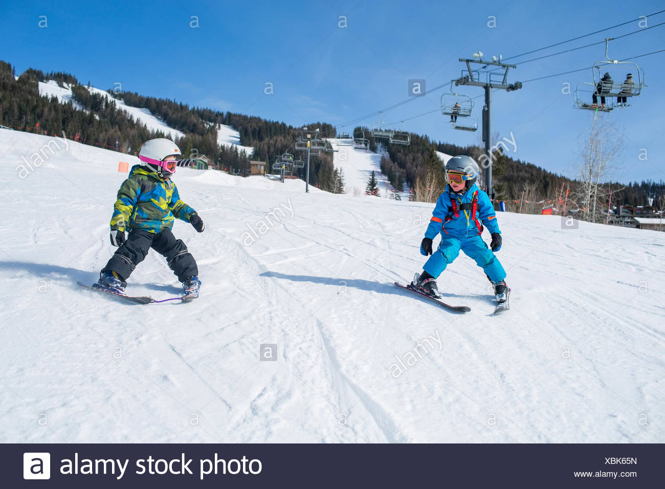 Little boys (4-5) learning skiing - Stock Image