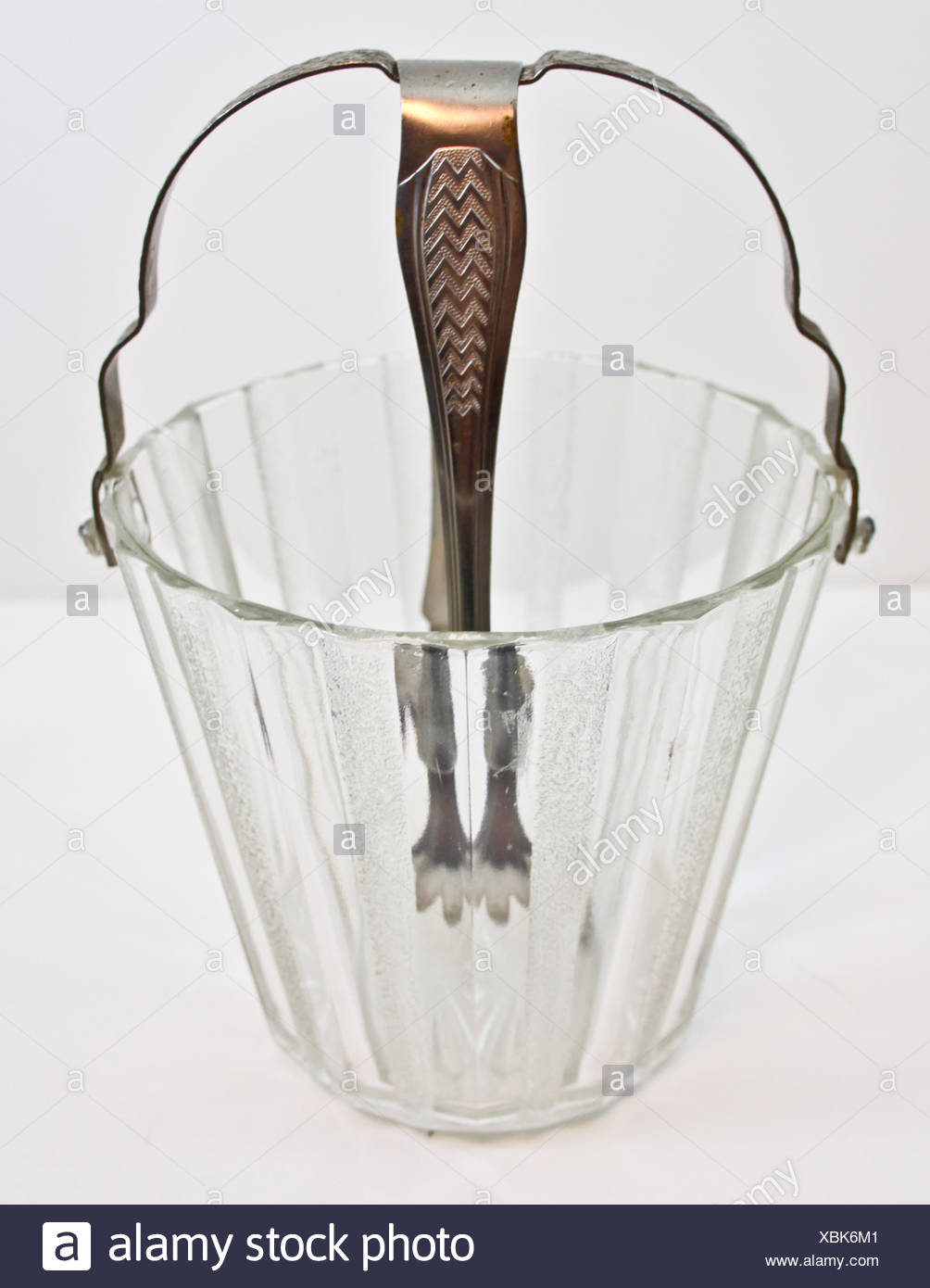 Close-Up Of Transparent Bucket Over White Background - Stock Image