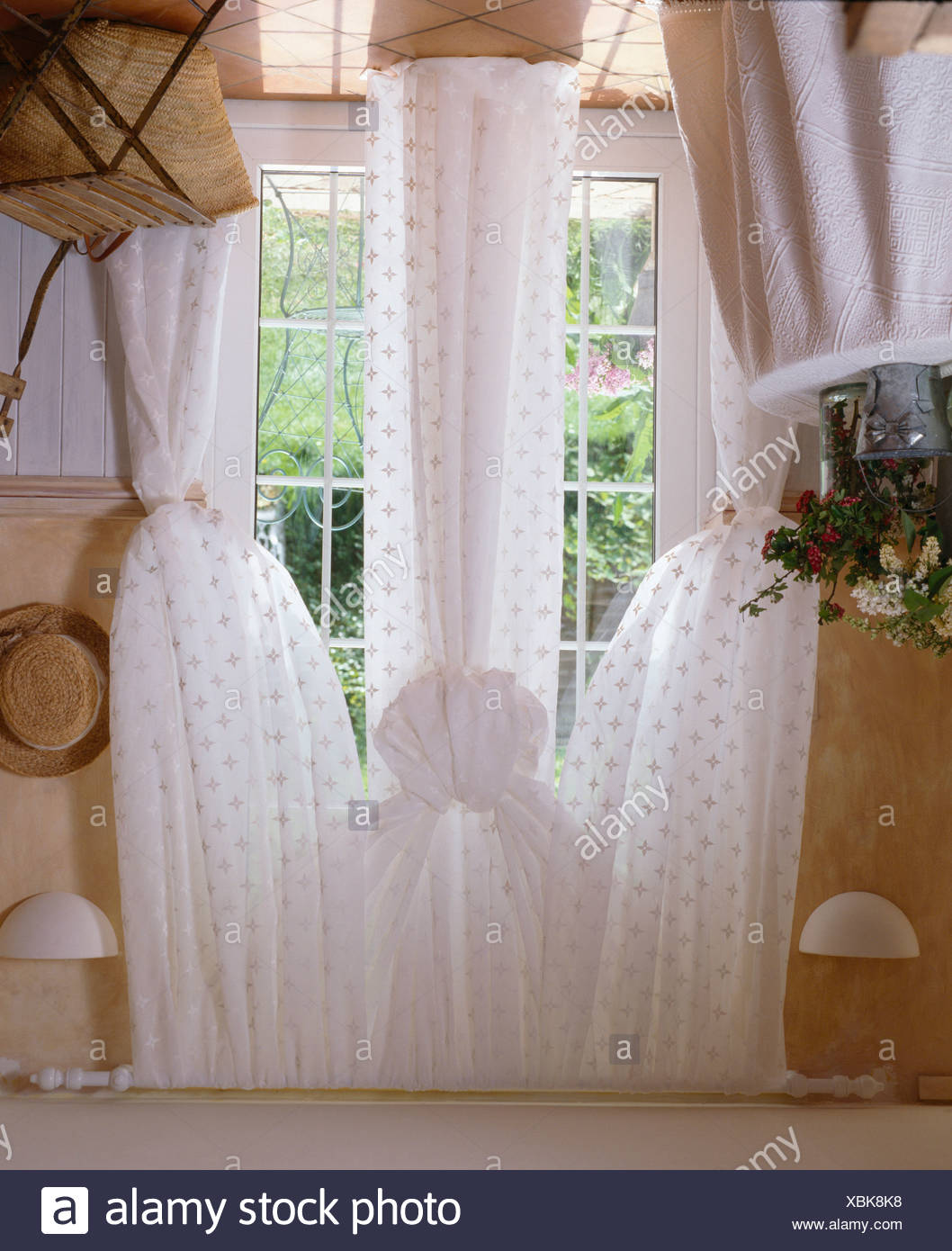 Spotted White Voile Drapes On French Windows In Country Dining Room
