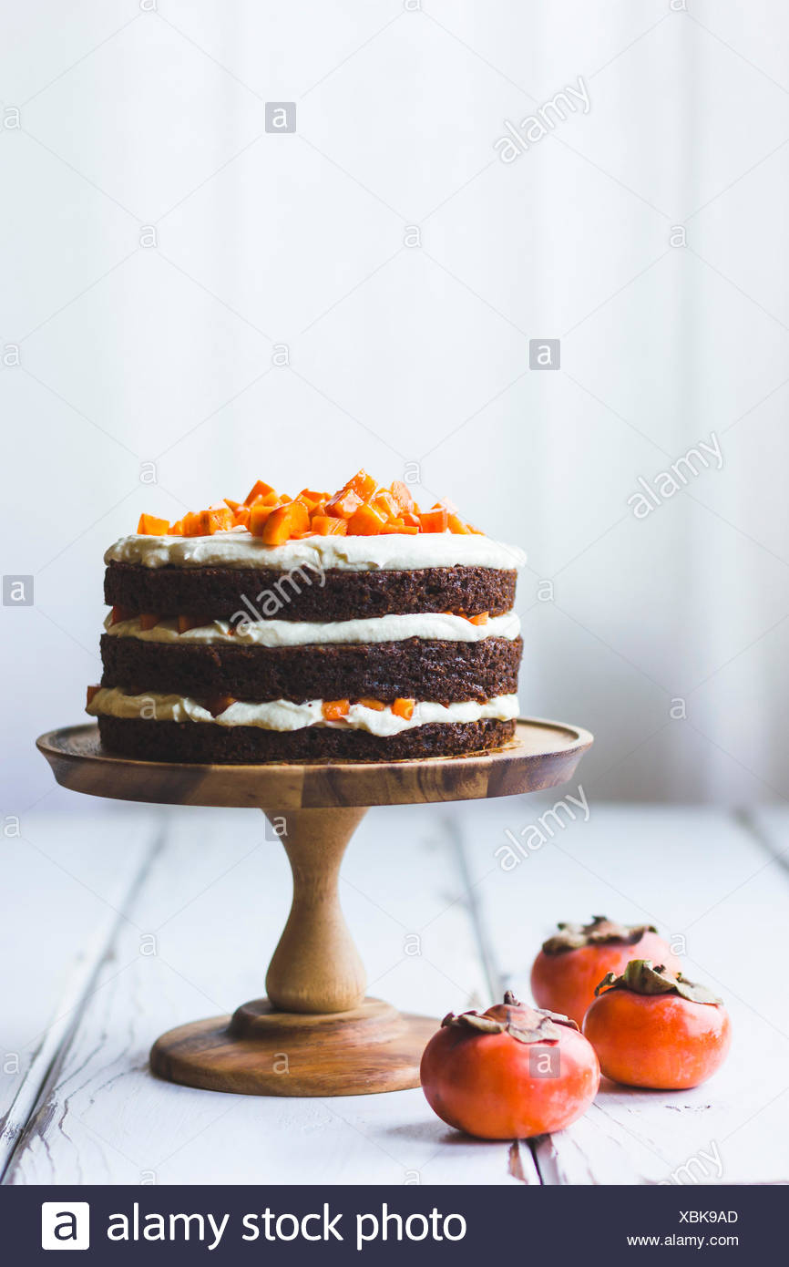 Persimmon layer cake - Stock Image