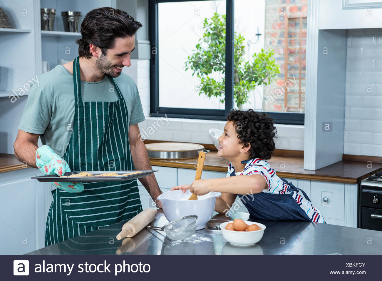 Smiling Father Son Cooking Biscuits Stock Photos & Smiling Father ...