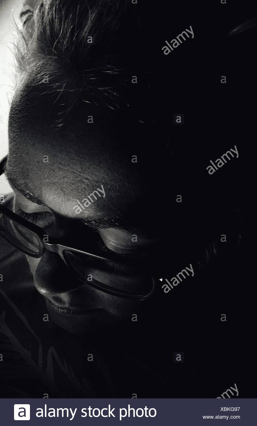 High Angle View Of Man With Eyeglasses At Home - Stock Image