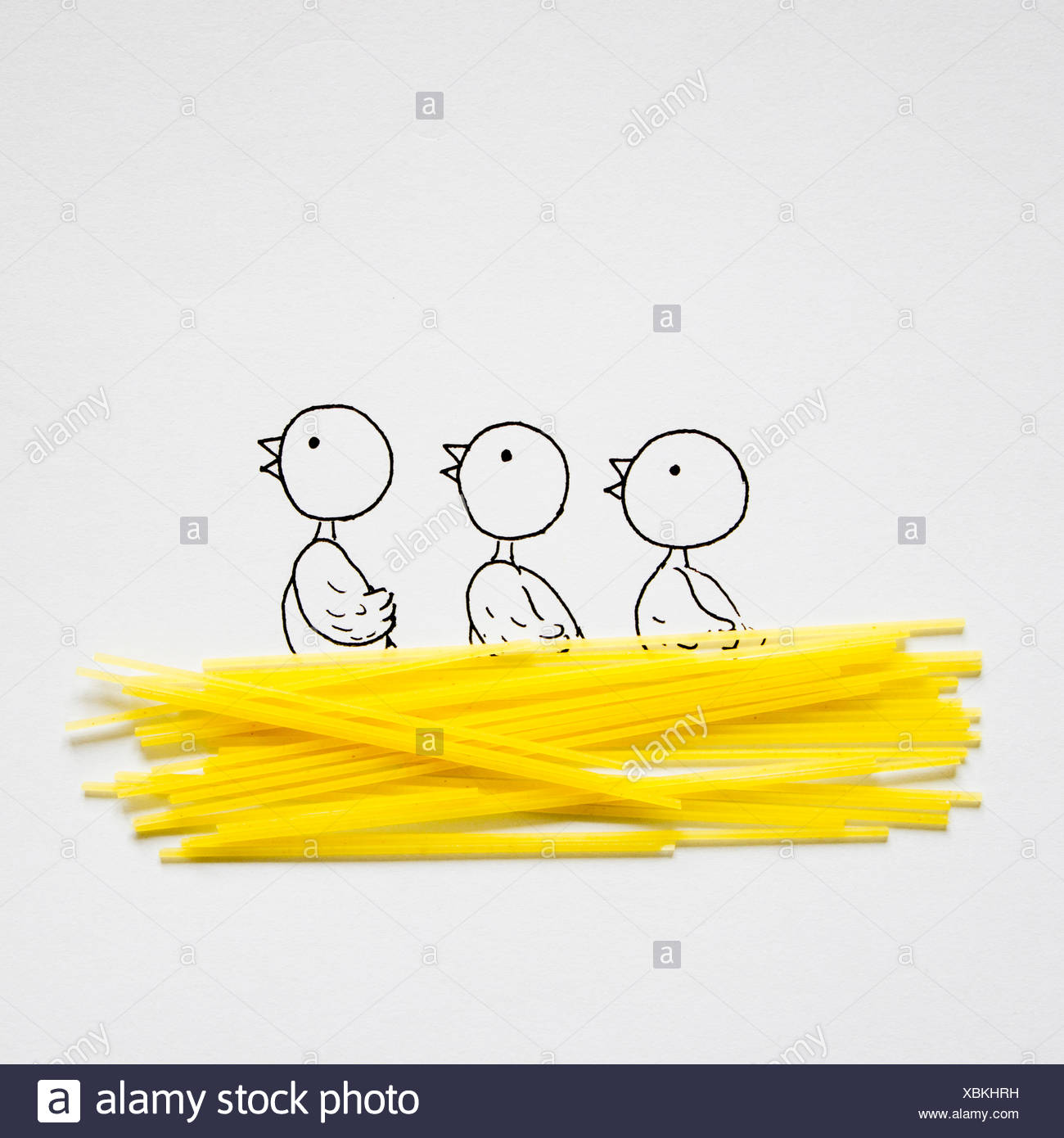 Conceptual drawing of three chicks in a birds nest - Stock Image
