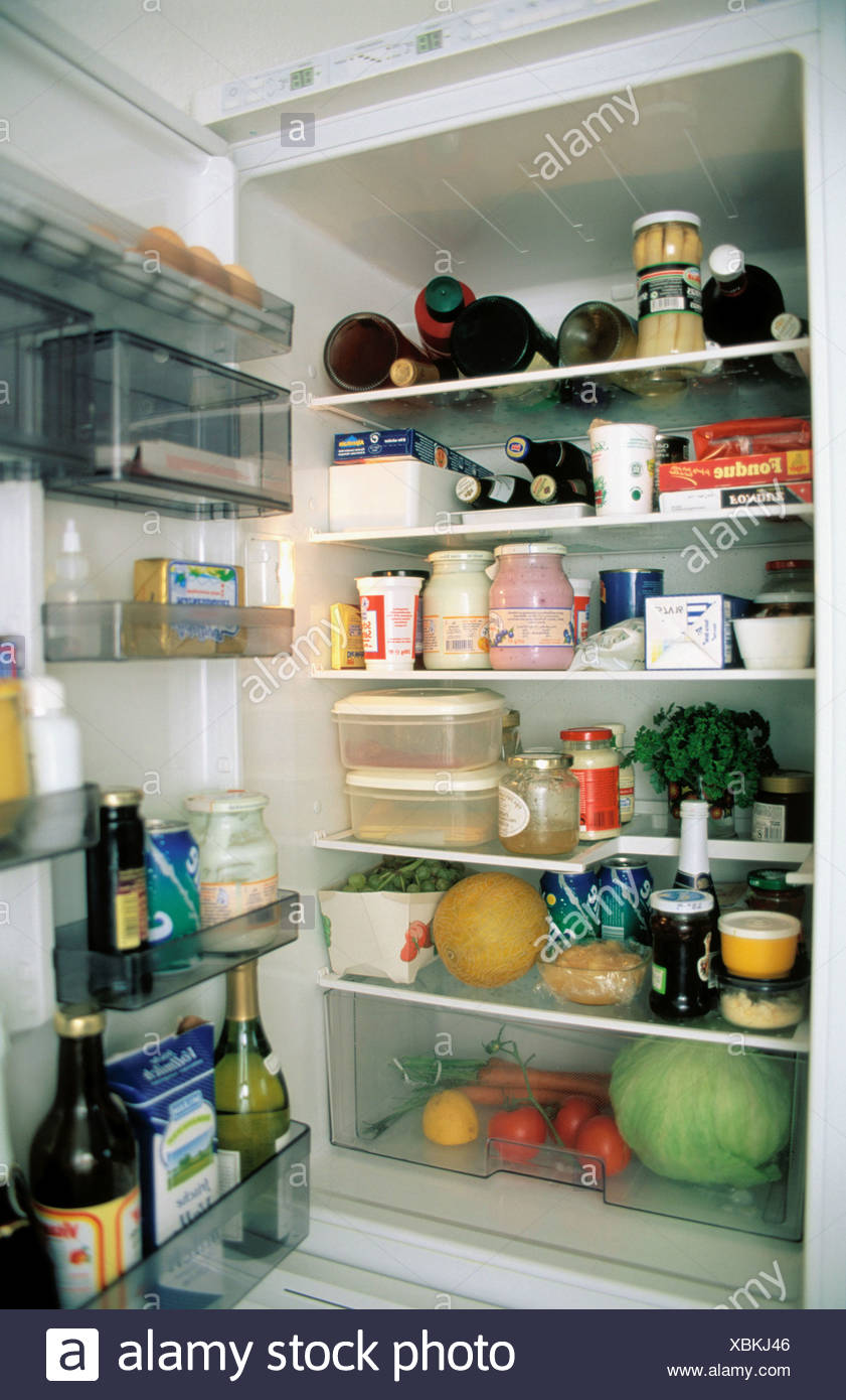 Food drinks appliance fridge open fully food eating chilly - Stock Image