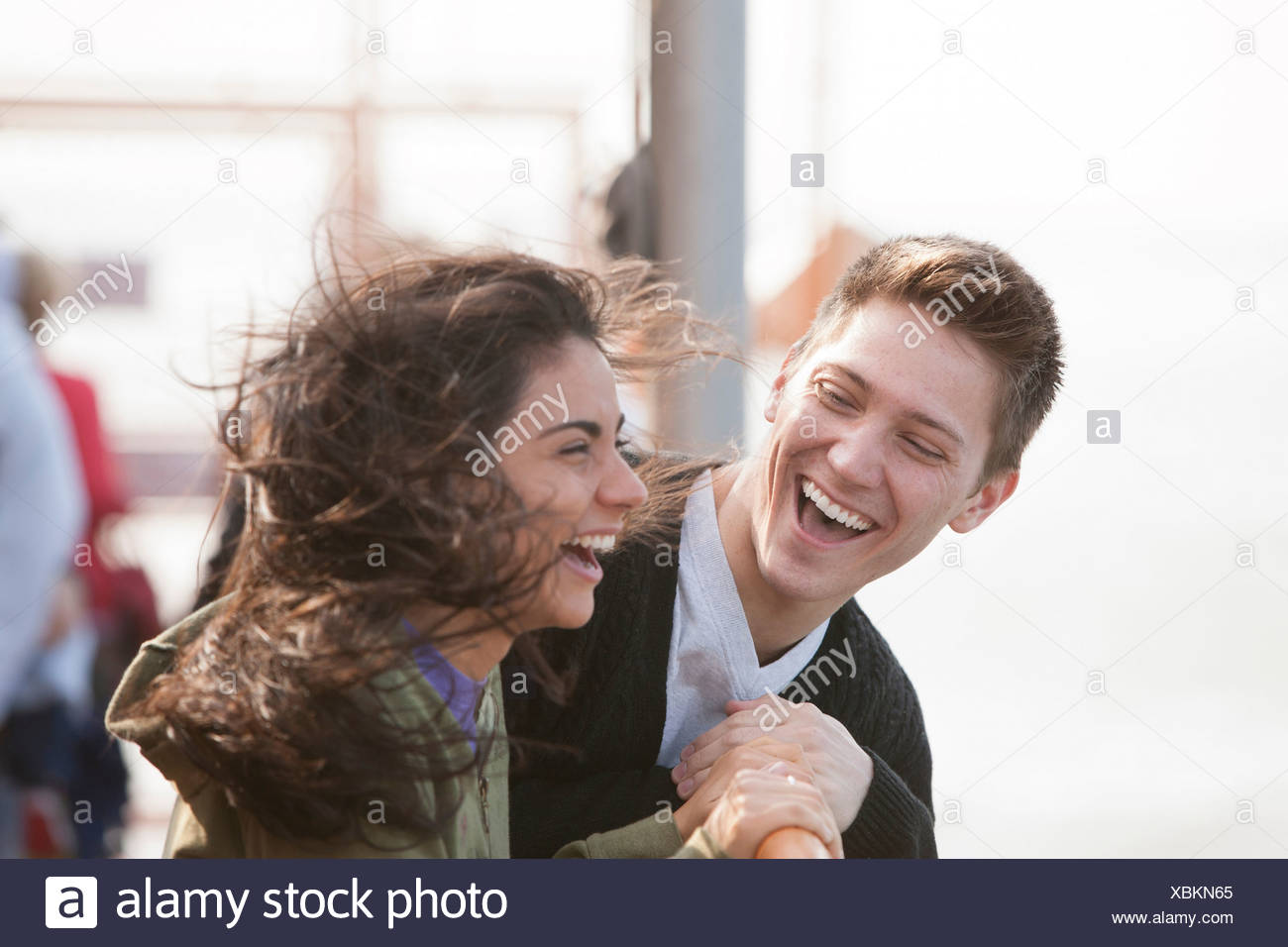 Young couple on ferry, laughing - Stock Image