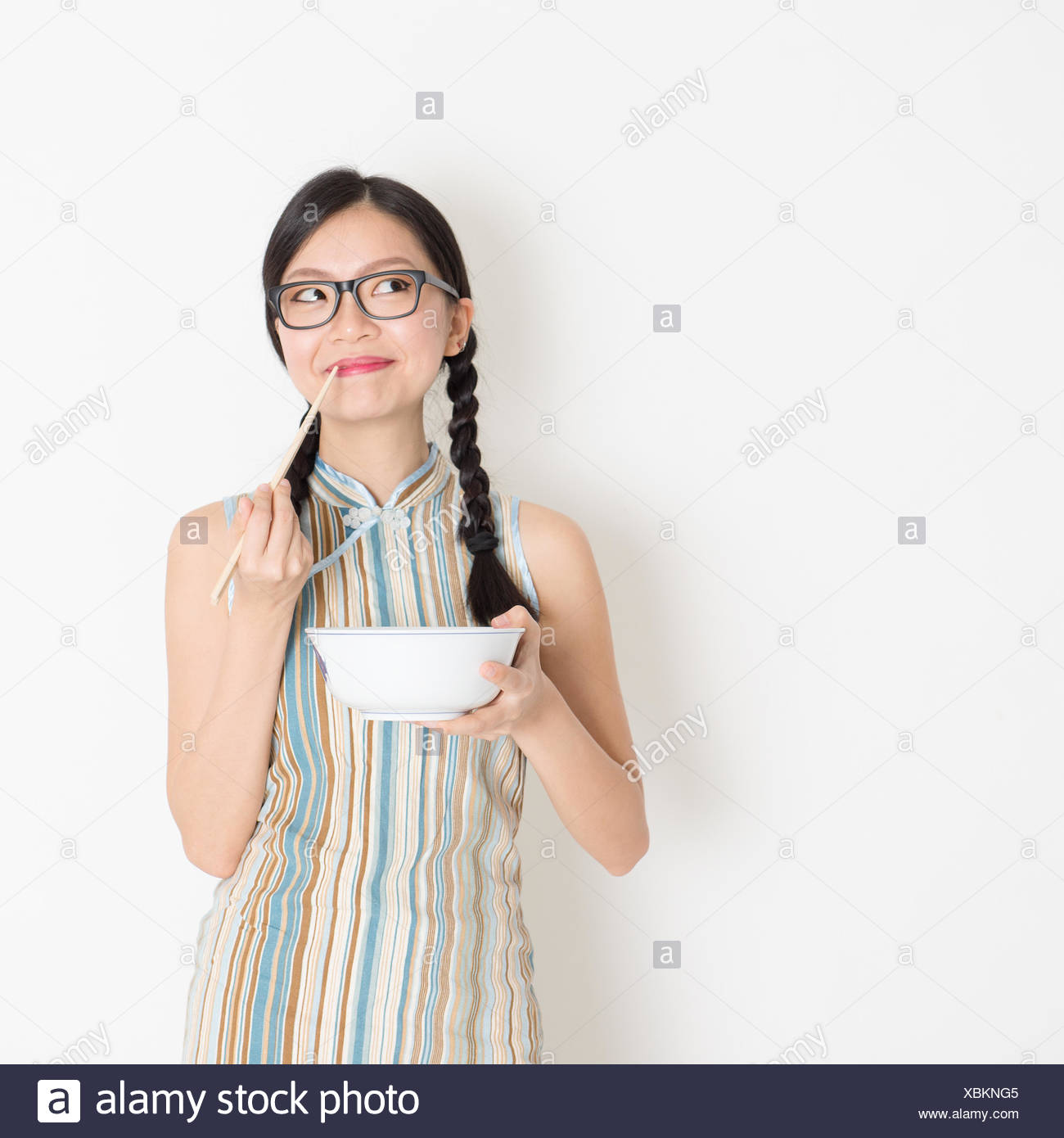 143fdf9ecf41 Portrait of Asian Chinese woman eating