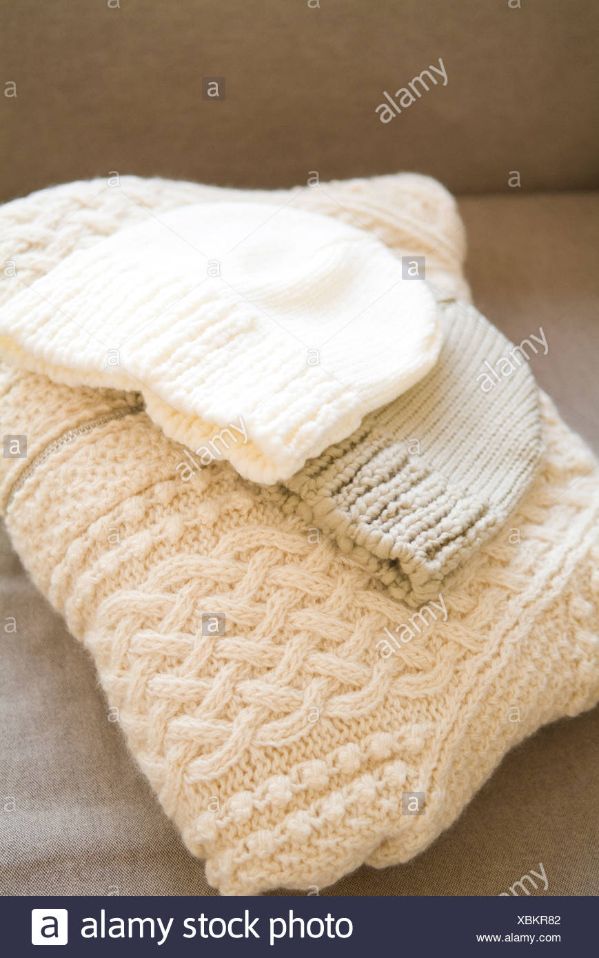 Knit hats and sweater - Stock Image