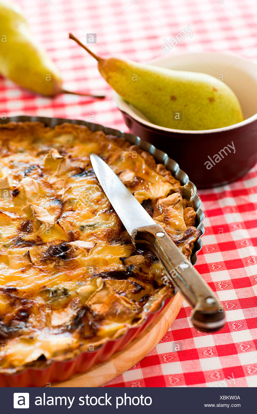 A quiche with pear and mushrooms - Stock Image