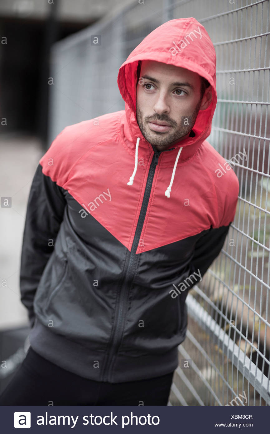 Sporty man in hooded jacket - Stock Image