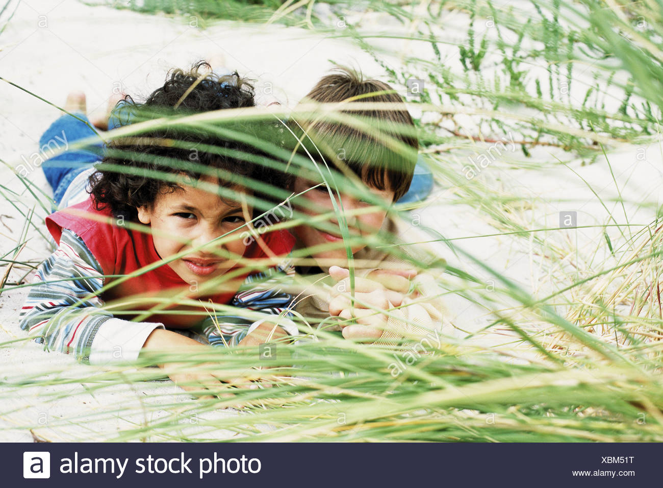Boys playing hide-and-seek Stock Photo