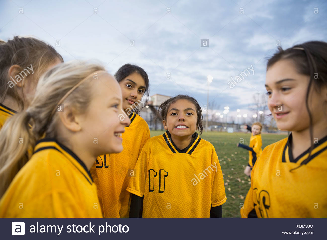 Soccer team on field at dusk Stock Photo