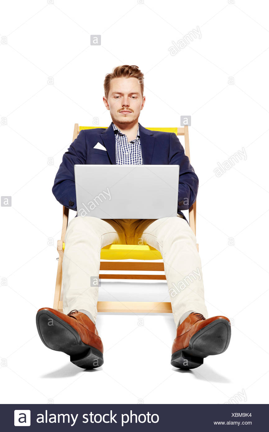 Man Working During Vacation - Stock Image